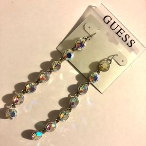 Guess rebels in wonderland dangling earrings.